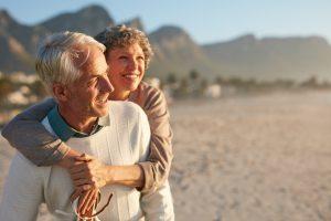 Senior couple enjoying their vacation at the beach